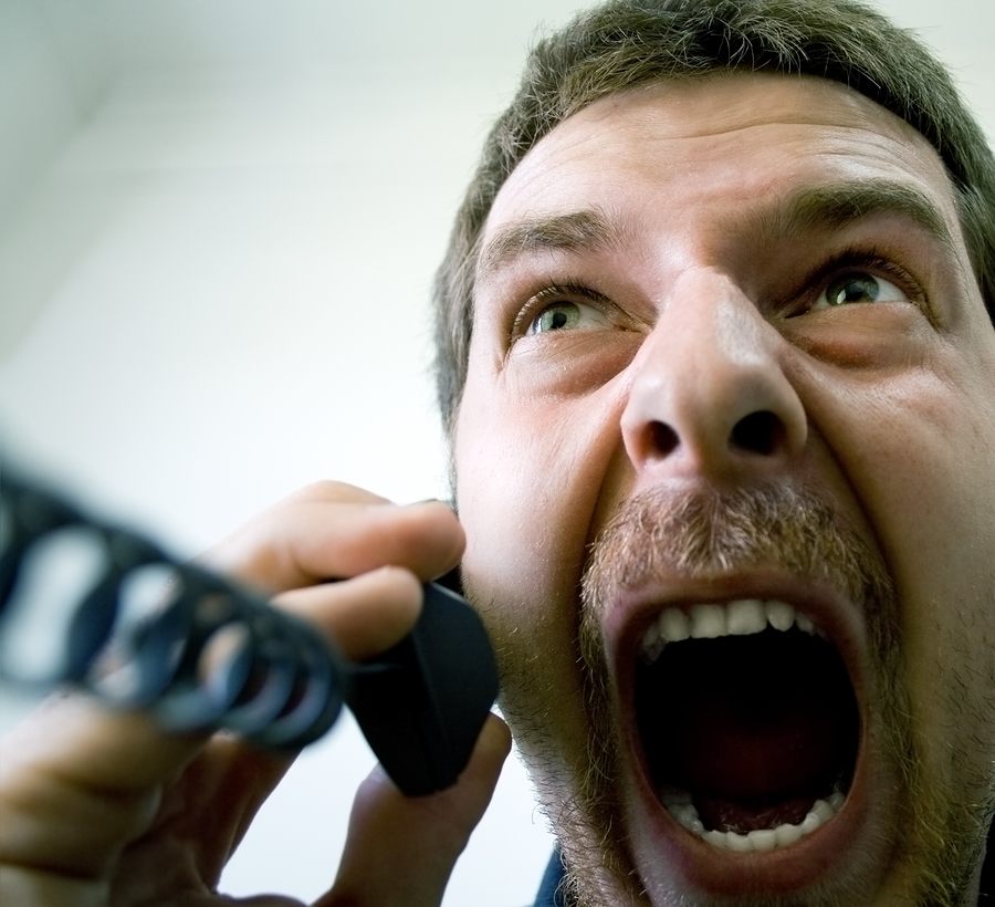 bigstockphoto_Angry_Stressed_Businessman_At__3929421